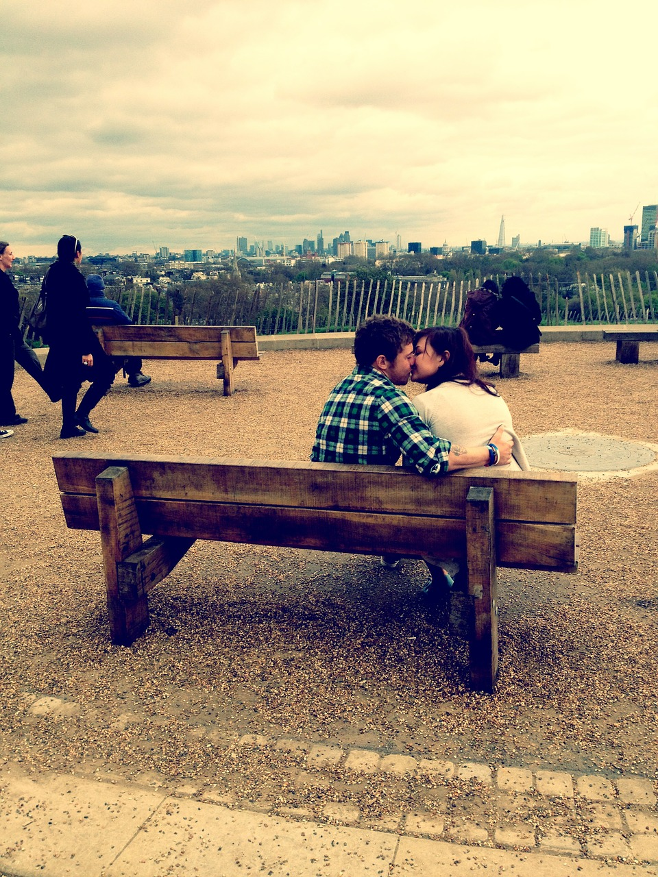 kiss on a park bench